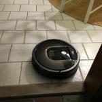 Roomba in motion, kitchen floor.  It made it over that marble threshold without any issues
